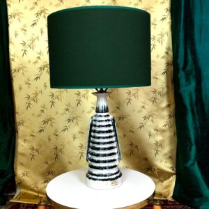 Pictured, Large Black and Stripe Table Lamp with evergreen shade, among the vintage rental furniture available from Catalyst Ranch