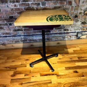 A hightop bar table with green floral decal, among the vintage rental furniture from Catalyst Ranch