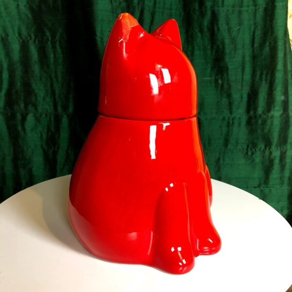 Pictured, red ceramic cat shaped cookie jar, available for event rental.