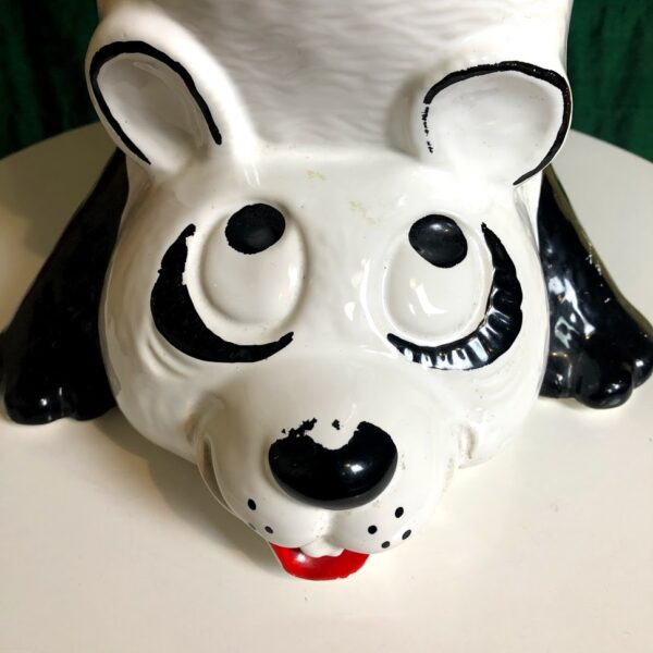 Pictured, close up on face of happy panda bear shaped cookie jar, available for event rental
