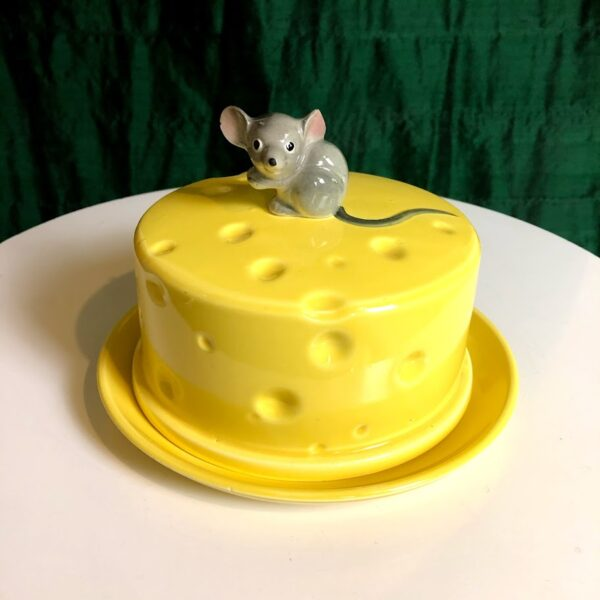 Pictured, ceramic butter cover tray. Handle is shaped like a mouse and the cover is a round block of yellow swiss cheese. Available for special event rental.