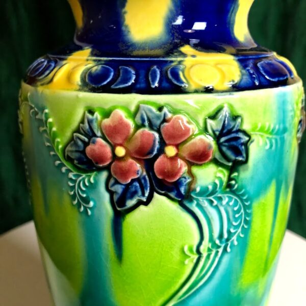 Close up, colorful hand painted flower vase.
