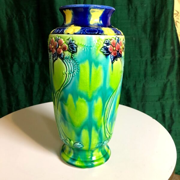 Pictured, colorful hand painted flower vase.