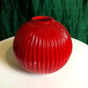 Pictured, small, round, ceramic vase available for event rental