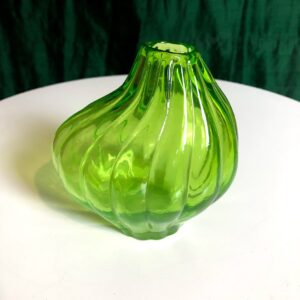Pictured, lime green glass vase for event rental