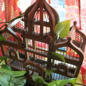 Pictured, ornate wooden bird cage