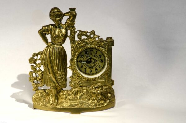 Pictured, standing golden clock with female figure