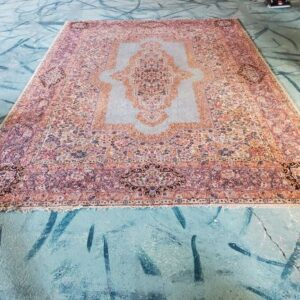 Pictured, Persian rug, among the vintage furniture of Catalyst Ranch