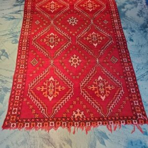 Pictured, Moroccan rug, among the vintage furniture of Catalyst Ranch