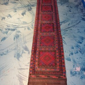 Pictured, brown & red flat weave runner among the vintage furniture of Catalyst Ranch