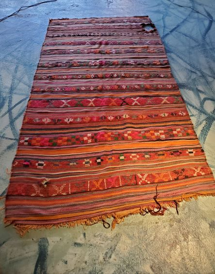 Pictured, striped vintage Moroccan rug, among the vintage furniture of Catalyst Ranch
