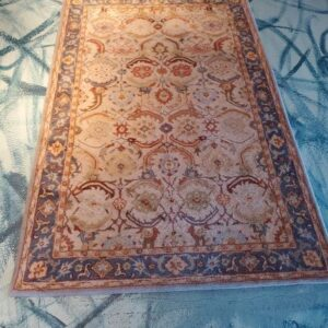 Pictured, light Persian rug, among the vintage furniture of Catalyst Ranch